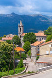 Houses and bell tower. Zonza, South Corsica. Typical Corsican village landscape, old living houses and bell tower. Zonza, South Corsica, France Royalty Free Stock Photos