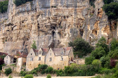 Houses at Beynac. Houses sling on to the sheer rock face at Beynac on the banks of the Dordogne river, France royalty free stock photography