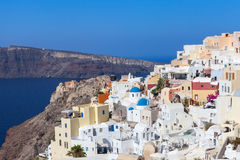 Houses and blue domes of Oia, Santorini. Royalty Free Stock Images