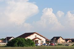 Modern houses. Houses with blue sky on the background Royalty Free Stock Photography