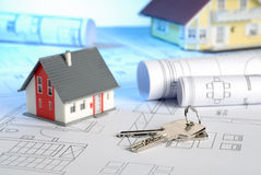 Houses with blueprints and keys Royalty Free Stock Images