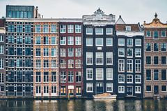 Houses and boat on Amsterdam canal Damrak with reflection. Ams royalty free stock images