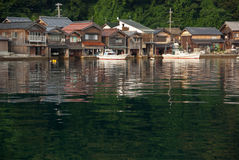 Houses with boat garage in Japan. Houses built on the water's edge with boat garages in Ine, Kyoto, Japan Stock Image