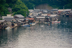 Houses with boat garage in Japan. Houses built on the water's edge with boat garages in Ine, Kyoto, Japan Royalty Free Stock Photo