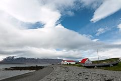 Houses and boat in Vigur island, Iceland Stock Photo