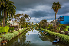 Houses and boats along a canal in Venice Beach  Stock Photos