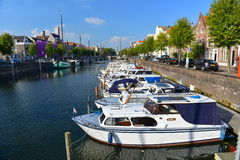 Houses and boats along river Nieuwe Maas at Delfshaven Stock Photography