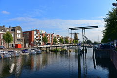 Houses and boats along river Nieuwe Maas at Delfshaven Royalty Free Stock Photo