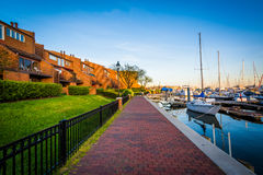 Houses and boats along the waterfront promenade, in Canton, Balt Royalty Free Stock Images