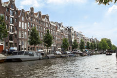 Houses and Boats on Amsterdam Canal Royalty Free Stock Photos