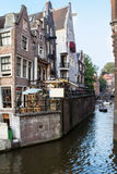 Houses and Boats on Amsterdam Canal. Holland Stock Photos