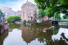 Houses and Boats on Amsterdam Canal Royalty Free Stock Image