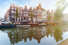 Houses and Boats on Amsterdam Canal Stock Photography