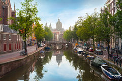 Houses and Boats on Amsterdam Canal Royalty Free Stock Images