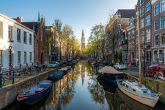 Houses and Boats on Amsterdam Canal, Netherlands. Morning photo stock photography