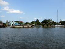 Houses and boats in cai be vietnam along the Mekong river delta Vietnam Stock Photos