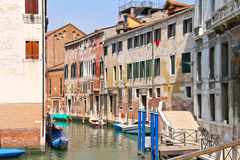 Houses and boats on one of the canals in Venice Royalty Free Stock Photo