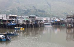 Houses and boats of Tai O Village. Hong Kong. Stock Photos
