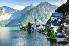 Houses Beside Body of Water and Mountains at Daytime royalty free stock photos