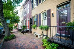 Houses and brick sidewalk in the Old Town of Alexandria, Virgini Royalty Free Stock Photo