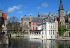 Houses in Bruges. Houses along a canal in Brugge stock photo