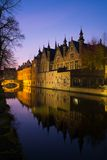 Houses in Bruges, Belgium. Houses along canal at night in Bruges, Belgium Stock Photo