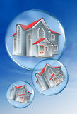 Houses in bubbles Royalty Free Stock Photo