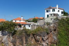Houses build at a cliff at Funchal, Madeira Island Stock Photo