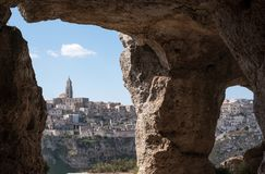 Houses built into the rock in the cave city of Matera, Basilicata Italy. Photographed from inside a cave in the ravine opposite. Houses built into the rock in stock image