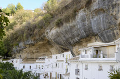 Houses  built into the rock walls Stock Image