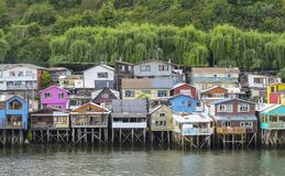 Palafitos houses in Castro, island of Chiloe in Chile. Houses built on stilts, known locally as Palafitos, lining the waters edge in Castro, capital of the Stock Image
