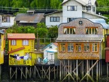 Palafitos houses in Castro, island of Chiloe in Chile. Houses built on stilts, known locally as Palafitos, lining the waters edge in Castro, capital of the Royalty Free Stock Image
