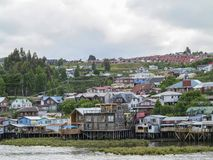 Palafitos houses in Castro, island of Chiloe in Chile. Houses built on stilts, known locally as Palafitos, lining the waters edge in Castro, capital of the Royalty Free Stock Photo
