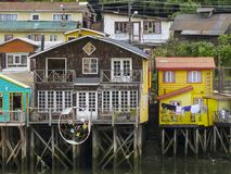 Palafitos houses in Castro, island of Chiloe in Chile. Houses built on stilts, known locally as Palafitos, lining the waters edge in Castro, capital of the Royalty Free Stock Images