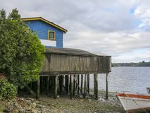 View of Castro, in Chiloe, Chile. Houses built on stilts, known locally as Palafitos, lining the waters edge in Castro, capital of the Island of Chiloe in Chile Royalty Free Stock Image