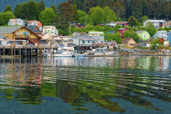 Houses and Businesses, Sitka Alaska. Houses, buildings, and boats reflected on the water of Sitka, Alaska, an island community on the inside passage of coastal Stock Photography