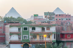 Houses in Cairo and pyramids of Giza at the background Royalty Free Stock Images