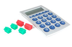 Houses and calculator on white Royalty Free Stock Photos
