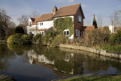Houses by canal Stock Photos