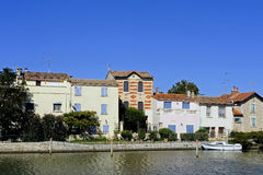 Houses on the canal in Aigues-Mortes Stock Image
