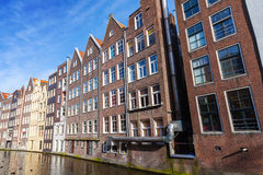 Houses on a canal in Amsterdam, Netherlands Stock Photo
