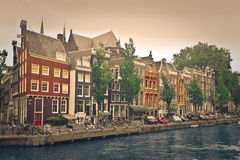 Houses on a canal in Amsterdam Royalty Free Stock Photo