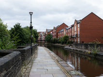 Houses by the canal. Houses in Manchester by a little canal Royalty Free Stock Photo
