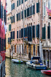 Houses on a Canal in Venice. Italy. Detail of houses walls in Venice Royalty Free Stock Photography