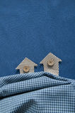 Houses from a cardboard on a fabric background Royalty Free Stock Images
