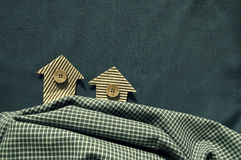 Houses from a cardboard on a fabric background Stock Photography