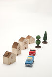Houses, cars, and trees on white background. Royalty Free Stock Photos