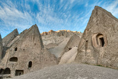 Houses carved into rock Stock Photos