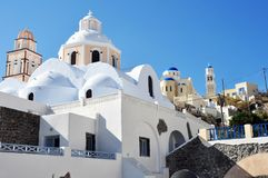 Detail blue roof of an Orthodox church and bell tower on the Greek island of Santorini. Houses and churches in Greece are covered with a layer of plaster Sovas Stock Photo