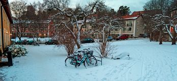Houses and classical vintage bicycles during winter. Beautiful scenery with classical vintage bicycles taken during winter. Snow is now resting on the bikes Royalty Free Stock Photos
